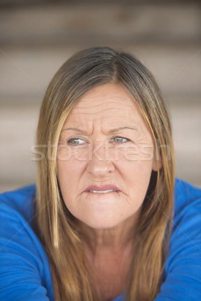 Nervous insecure woman portrait Stock photo © roboriginal