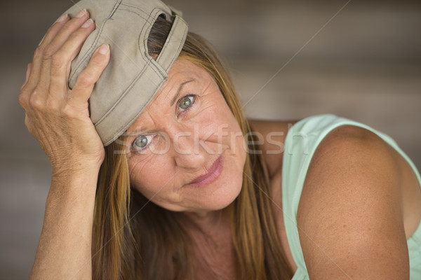 Active fit sporty mature woman sporty cap Stock photo © roboriginal