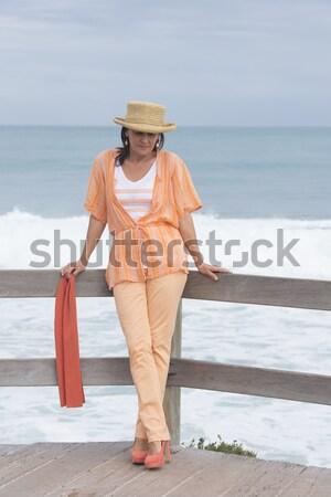 Magányos szexi érett nő óceán portré vonzó Stock fotó © roboriginal