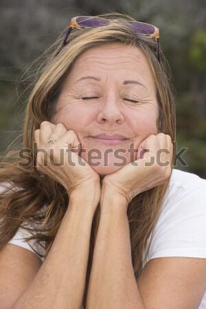 Attractive relaxed mature woman outdoor Stock photo © roboriginal