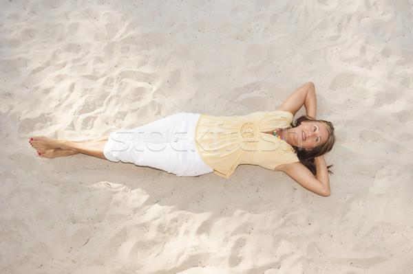 Relaxed happy senior woman at beach Stock photo © roboriginal