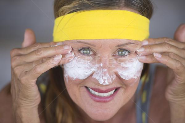 Hautpflege Lotion reife Frau Porträt sportlich passen Stock foto © roboriginal