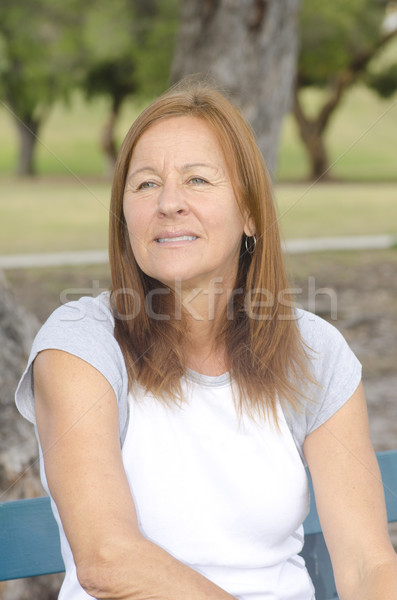Portrait sad lonely mature woman outdoor Stock photo © roboriginal