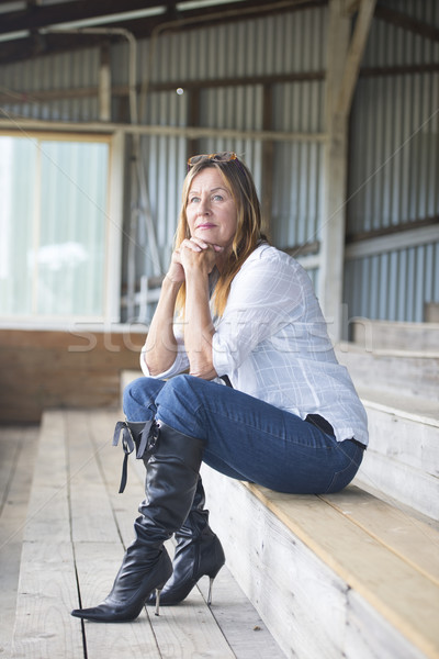 Thoughtful mature woman in jeans and high heels Stock photo © roboriginal