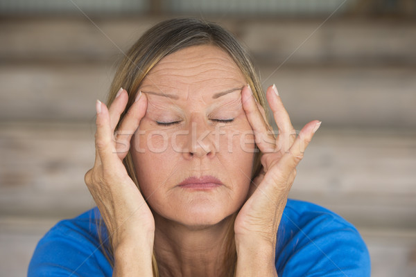 Woman in pain with migraine headache Stock photo © roboriginal