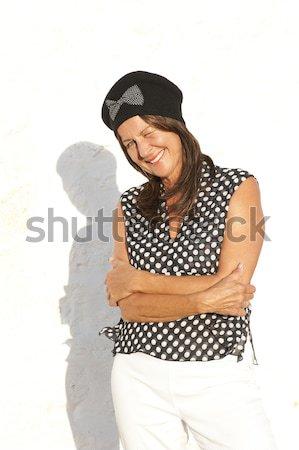 Grappig rijpe vrouw zwart wit blouse portret gelukkig Stockfoto © roboriginal