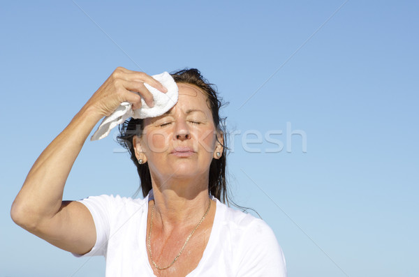 Mature woman exercise stress sweating Stock photo © roboriginal