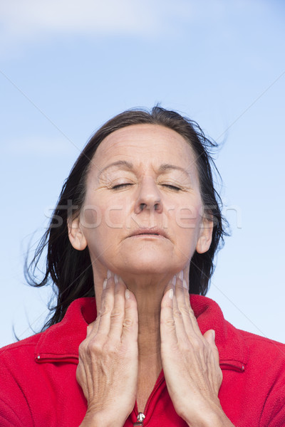 Woman suffering from pain in throat Stock photo © roboriginal