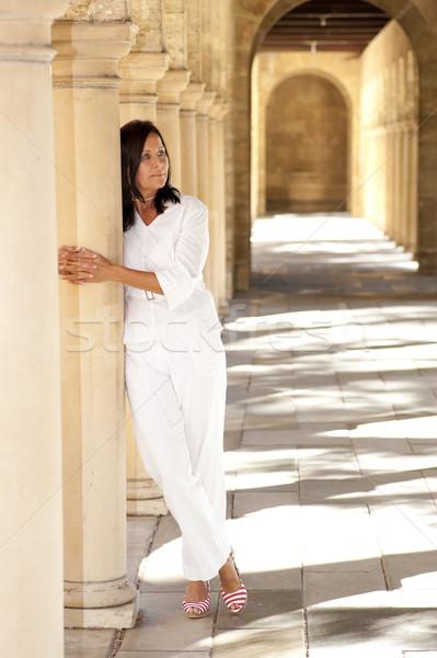 Attractive romantic mature woman archway Stock photo © roboriginal