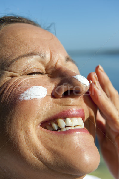 Stock photo: Woman Skin cancer protection suncream