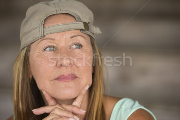 Active fit attractive mature woman sporty cap Stock photo © roboriginal