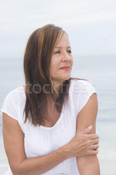 Lonely mature woman portrait outdoor Stock photo © roboriginal