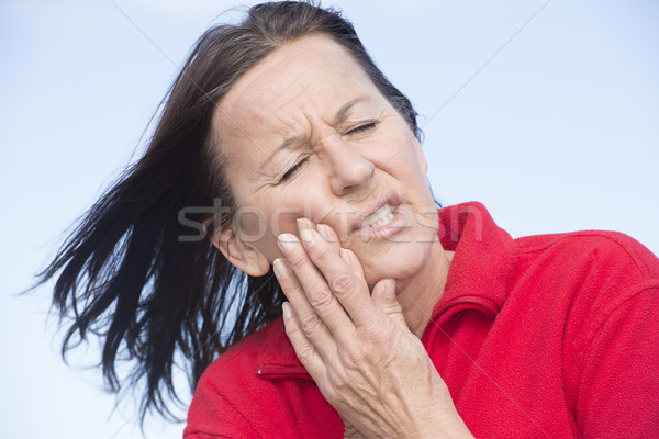 Nő fájdalmas fogfájás szenvedés portré vonzó Stock fotó © roboriginal