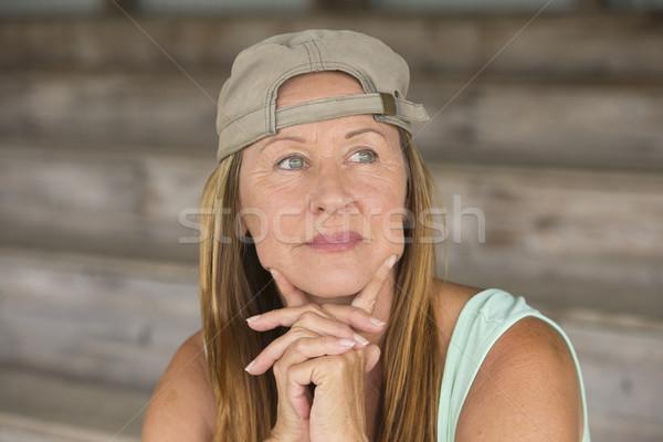 Active fit confident mature woman sporty cap Stock photo © roboriginal