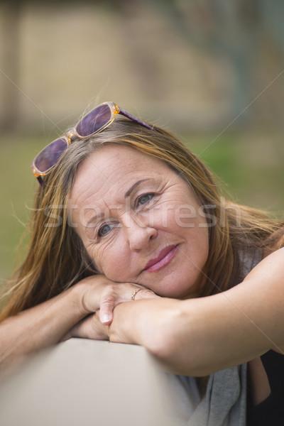 Attractive relaxed mature woman Stock photo © roboriginal