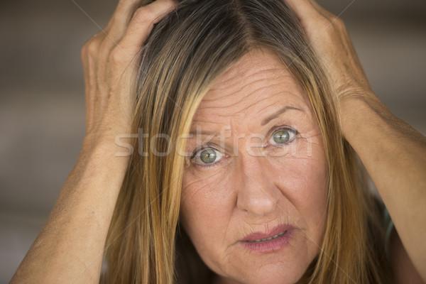 Ijedt nő kezek fej portré vonzó Stock fotó © roboriginal