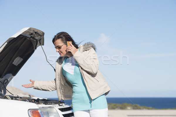 Stock photo: Woman car break down assistance