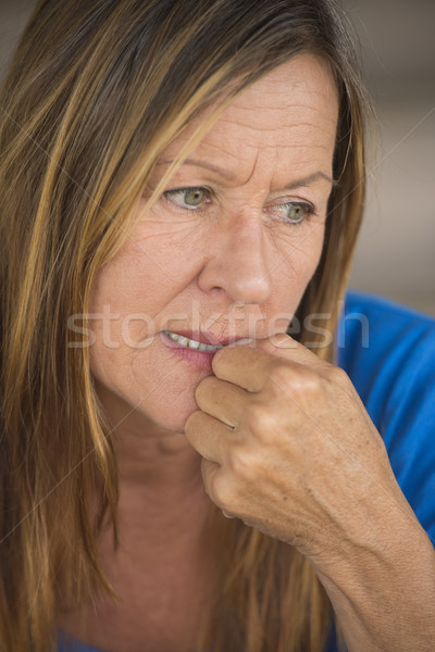 Lonely nervous woman biting insecure finger nails Stock photo © roboriginal
