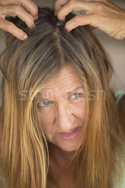 Stressed Woman tearing her hair with hands Stock photo © roboriginal