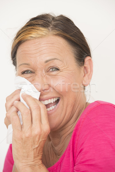 Happy friendly woman with tissue Stock photo © roboriginal