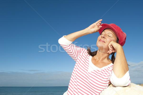 Stylish relaxed mature woman outdoor Stock photo © roboriginal