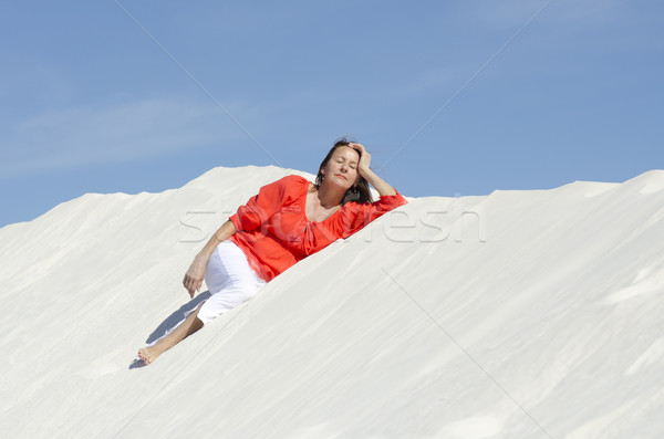 Pretty woman lying relaxed on sand dune Stock photo © roboriginal