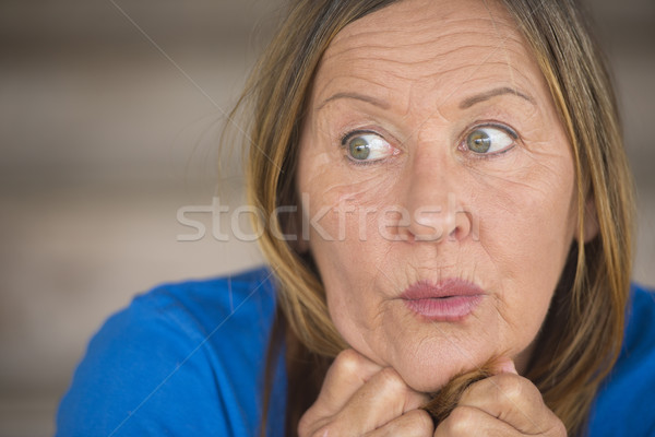 Surprised anxious woman portrait Stock photo © roboriginal