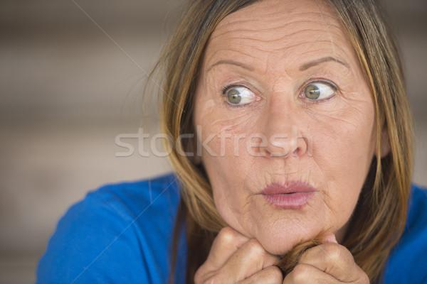 Zdziwiony niespokojny portret kobiety portret atrakcyjny starsza kobieta Zdjęcia stock © roboriginal