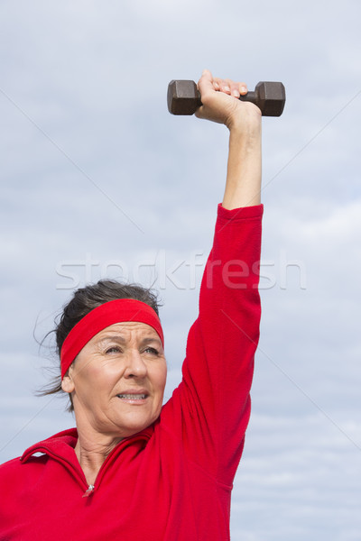 Energetic mature woman weights exercising Stock photo © roboriginal