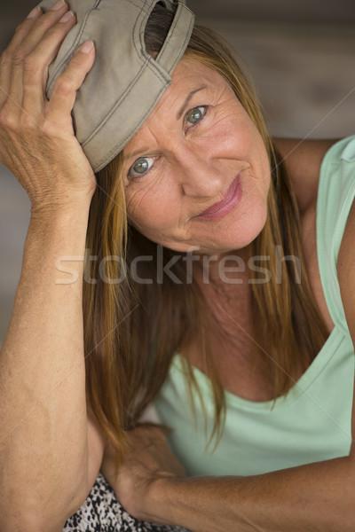 Active fit friendly mature woman sporty cap Stock photo © roboriginal