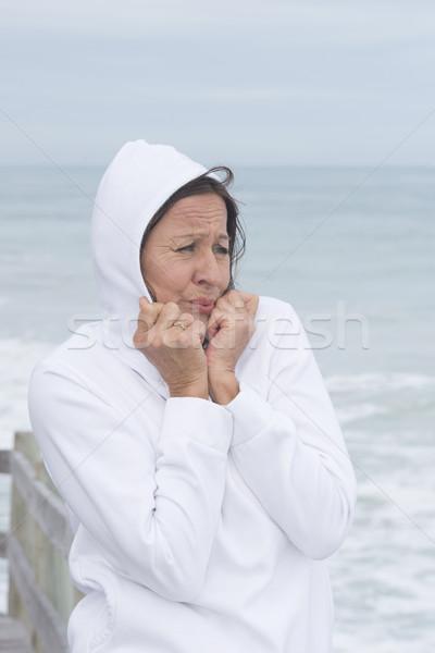 Woman white jumper cold season at sea Stock photo © roboriginal