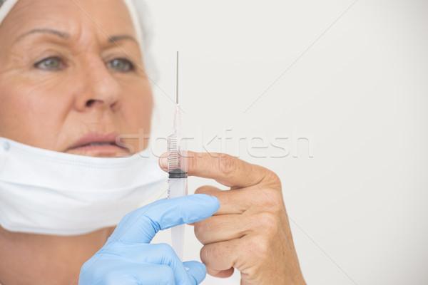 Enfermera gripe vacunación inyección retrato profesional Foto stock © roboriginal