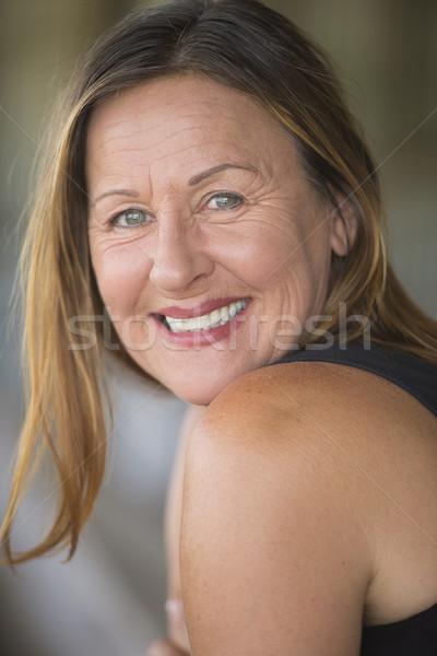 Confident relaxed smiling mature woman portrait Stock photo © roboriginal