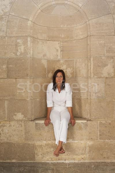 Portrait lonely mature woman sitting in alcove Stock photo © roboriginal