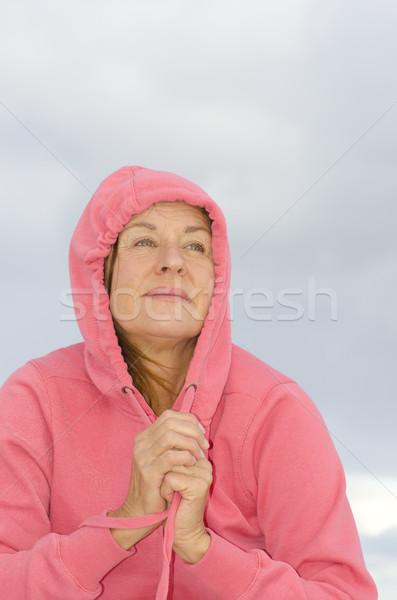 Daydreaming mature woman Stock photo © roboriginal
