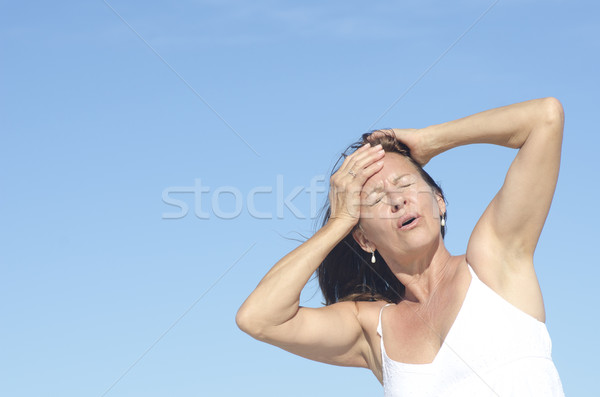 Woman portrait menopause and headache Stock photo © roboriginal