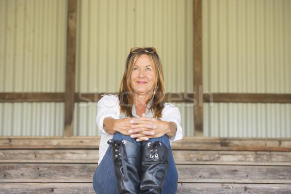 Mature woman sitting confident smiling outdoor Stock photo © roboriginal