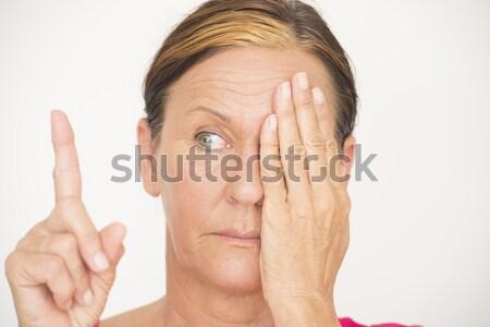 Woman Eyesight focus test on finger Stock photo © roboriginal