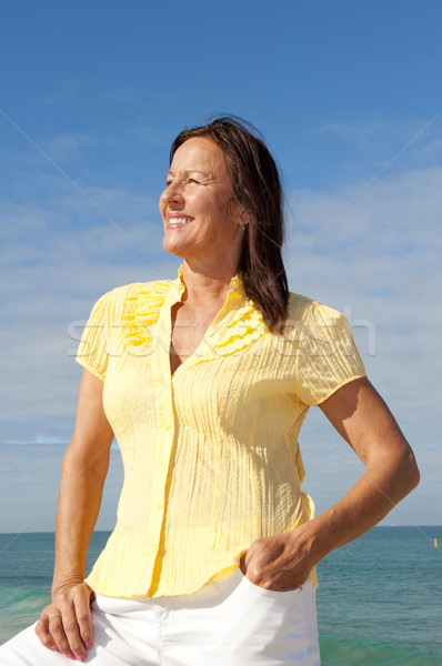 Attractive mature woman ocean background Stock photo © roboriginal