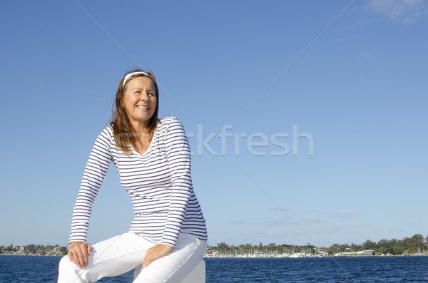 Beautiful happy mature woman marine background  Stock photo © roboriginal