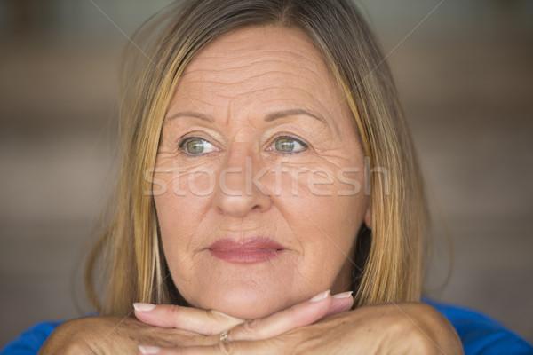 Happy relaxed smiling mature woman portrait Stock photo © roboriginal