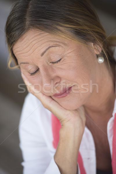 Relaxed mature woman closed eyes portrait Stock photo © roboriginal