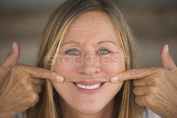 пальца рот улыбка портрет Сток-фото © roboriginal