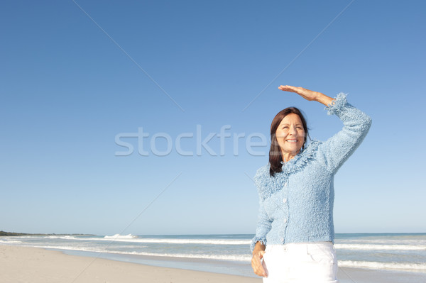Attractive mature woman ocean isolated  Stock photo © roboriginal