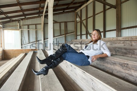 Relaxed Thoughtful woman outdoor sitting Stock photo © roboriginal