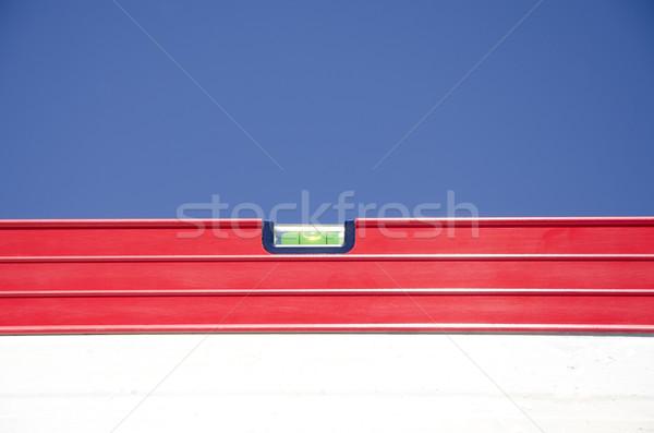 Kırmızı ruh seviye açık inşaat mavi gökyüzü Stok fotoğraf © roboriginal