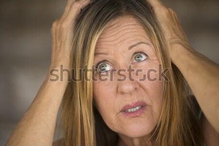 Unhappy woman with hands on head Stock photo © roboriginal