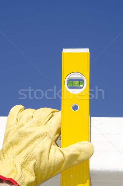 Mãos luvas espírito nível ao ar livre construção Foto stock © roboriginal