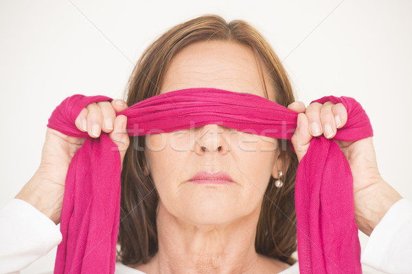 Portrait middle aged woman blindfolded Stock photo © roboriginal