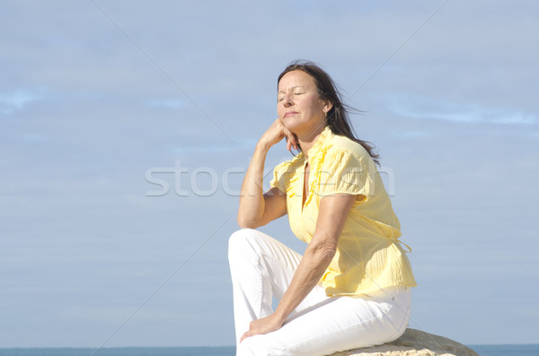 Relaxed senior woman ocean background Stock photo © roboriginal